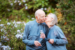 Loving couple kissing in garden Stock Photography