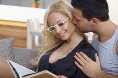 Loving couple kissing at home Stock Images