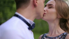 Loving couple kissing and hugging in Park close-up stock video footage