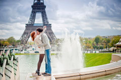 Loving couple kissing near the Eiffel Tower in Par Royalty Free Stock Photo