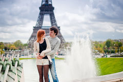Loving couple kissing near the Eiffel Tower in Paris Stock Images