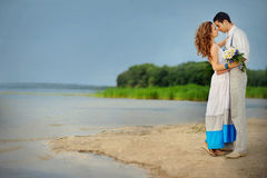 Loving couple kissing near the lake Royalty Free Stock Photo
