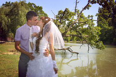 Loving couple kissing near riverside. Beautiful landscape Royalty Free Stock Images