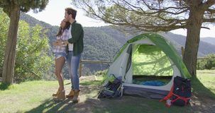 Loving couple kissing near tent stock video footage