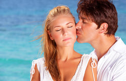 Loving couple kissing outdoors. Closeup portrait of loving couple kissing outdoors, summer vacation concept Stock Photography