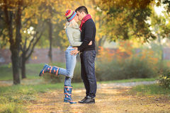 Loving couple kissing in the park. In autumn Royalty Free Stock Image