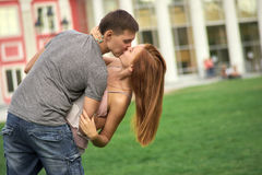 A loving couple kissing in the park Royalty Free Stock Images