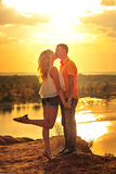 Loving couple kissing passionately at sunset. Royalty Free Stock Images