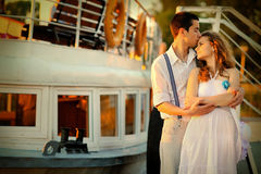 Loving couple kissing on the pier Royalty Free Stock Photography