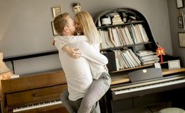 Loving couple kissing in the room. Happy and loving couple kissing in the room Royalty Free Stock Images
