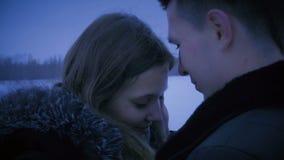 Loving couple kissing on street in winter. stock video