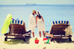 Loving couple kissing on tropical beach Stock Images