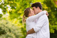 Loving couple kissing. Loving young couple kissing outdoors Royalty Free Stock Images
