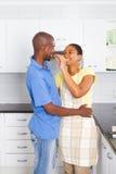 Loving couple in kitchen stock photo