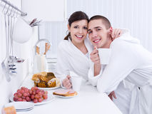 Loving couple in the kitchen Royalty Free Stock Image