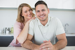 Loving couple at kitchen counter Royalty Free Stock Images