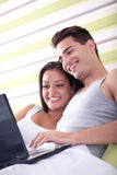 Loving couple with laptop Stock Photo
