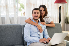 Loving couple with a laptop Royalty Free Stock Images