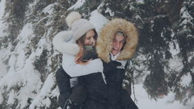 Loving couple laughing in a winter park stock video footage