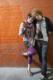 Loving Couple Leaning On Brick Wall Stock Images