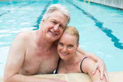 Loving couple leaning at poolside Stock Photos