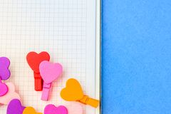 A loving couple of hearts on white paper on a blue background. T stock photo