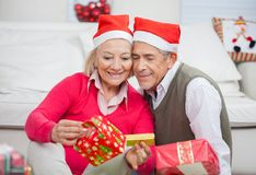 Loving Couple Looking At Christmas Gifts Royalty Free Stock Image