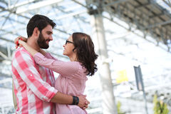 Loving couple looking at each other while embracing outside building Royalty Free Stock Images