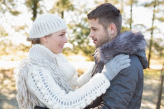 Loving couple looking at each other in winter wear outdoors Stock Photography