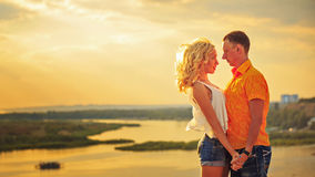 Loving couple looking into each others eyes at sunset. Royalty Free Stock Photo
