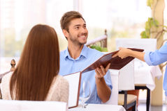Loving couple looking through menu in the Royalty Free Stock Photography
