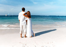 Loving couple looking the ocean Royalty Free Stock Photo