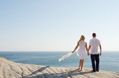 Loving couple looking at the sea Royalty Free Stock Photography