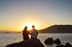Loving couple looking at the sun Stock Photo