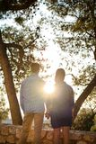 Loving couple looking at the sun stock image