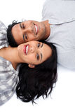 Loving couple lying on the floor Royalty Free Stock Images