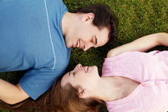 Loving couple lying on a grass Royalty Free Stock Image