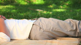 Loving  couple lying on the grass stock video footage