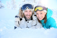 Loving couple lying in the snow Royalty Free Stock Images