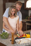 Loving couple makes dinner together Stock Photography