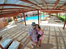 Loving couple making selfy near swimming pool Stock Images