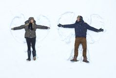 Loving couple making snow angel Royalty Free Stock Photo