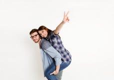 Loving couple, man piggybacking girlfriend, cutout. Loving couple piggybacking. Happy young men with his girlfriend, white isolated studio background, copy space Stock Image