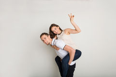 Loving couple, man piggybacking girlfriend Stock Photography