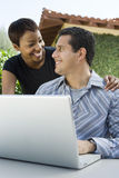 Loving Couple With Man Using Laptop Stock Images