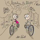 Loving couple man and woman on bicycles Royalty Free Stock Photography