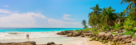 Tropical Sandy Beach on Caribbean Sea. Mexico. A loving couple, man and woman at tropical sandy Beach on Caribbean Sea. Yucatan, Mexico Stock Image