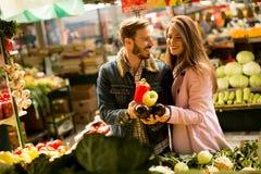 Loving couple on market Royalty Free Stock Photography