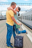 Loving couple meeting at the  station Stock Images
