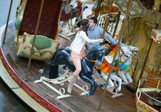 Loving couple on a merry-go-round Royalty Free Stock Image